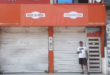 xiaomi hiding cover retail store branding with made in india logo anti china campaign fear